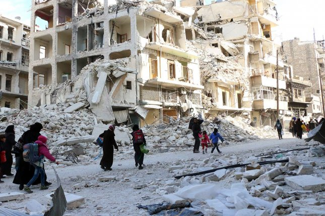 Bombed-out buildings are just one of the many obstacles to rebuilding the city of Aleppo, Syria. File Photo courtesy of Aleppo Media Center/EPA