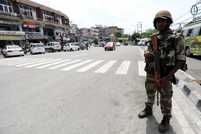 An Indian paramilitary soldier stands guard on August 14 in Jammu, the winter capital of India-controlled Kashmir. The Indian Kashmir region was placed under heavy lockdown after the Indian government stripped its autonomy. File Photo by Jaipal Singh/EPA-EFE