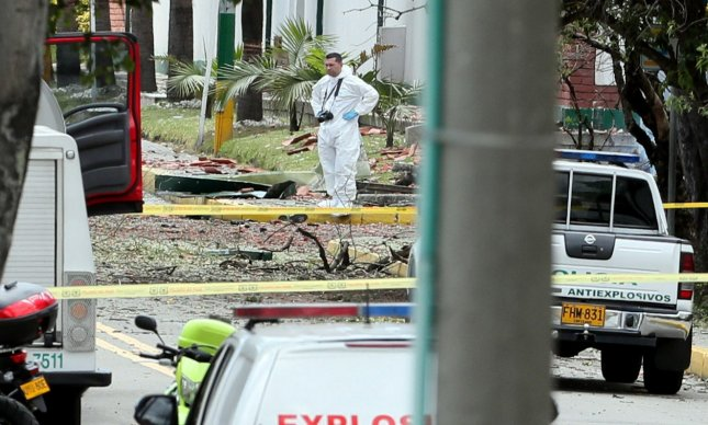 Members of the Colombian Technical Investigation Team work at the place where a bomb car caused an explosion at the Santander General Police School in Bogota, Colombia, on Thursday. Photo by Mauricio Duenas Castaneda/EPA-EFE