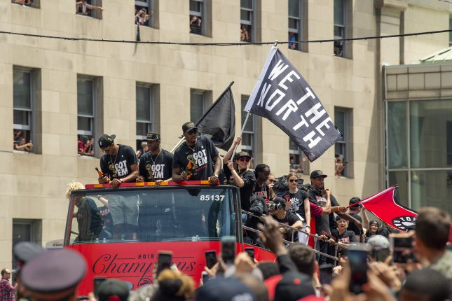 Toronto police arrested two suspects and confiscated two firearms after a shooting at a parade celebrating the Toronto Raptors' NBA championship. Photo by Warren Toda/EPA-EFE