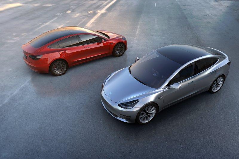 A cheaper Tesla Model 3 will be hitting the streets next year. Photo by Tesla Motors/EPA