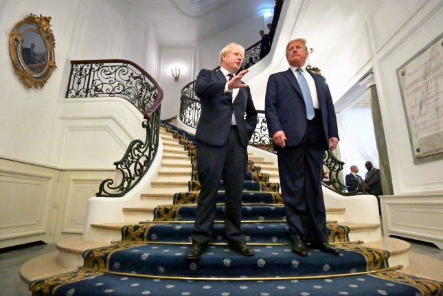 Britain's Prime Minister Boris Johnson (L) and U.S. President Donald Trump pose as they arrive for a bilateral meeting during the G7 summit in Biarritz, France. Photo by Dylan Martinez/EPA/pool