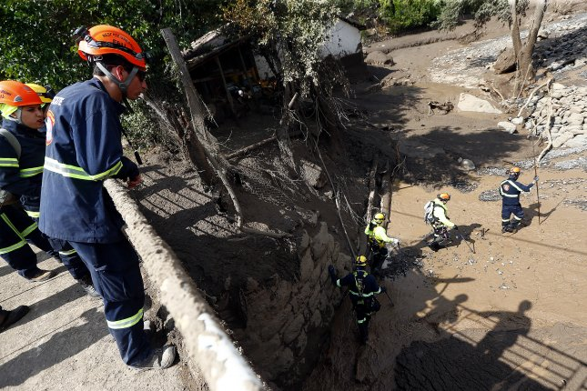Chilean rescue and search teams look for victims after heavy rains caused landslides in the San Jose de Maipo region near Santiago, Chile, on Sunday. File Photo by Esteban Garay/EPA
