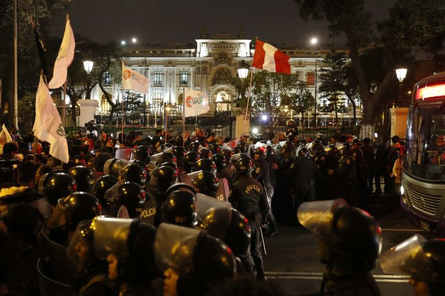 As citizens celebrate the announcement of the dissolution of Congress by President of Peru Martin Vizcarra, outside the Legislative Palace in Lima, Peru, on Monday, opposition lawmakers were calling it an act of a dictator. Photo by Paolo Aguilar/EPA-EFE