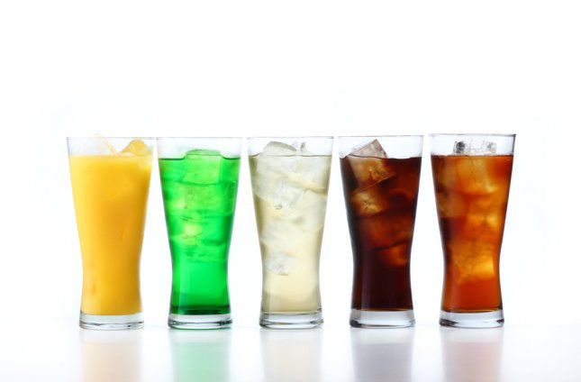Sugar-sweetened drinks such as soda and many fruit juices have been linked to a range of conditions that make up metabolic syndrome -- all of which increase risk for heart disease. Photo by taa22/Shutterstock