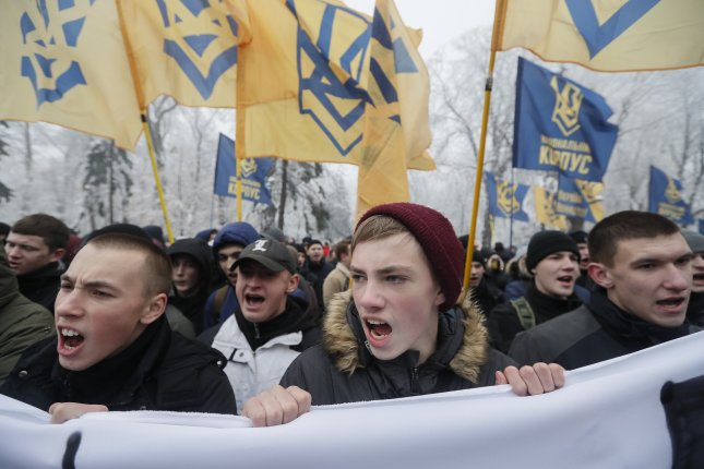 Ukrainian nationalists attend a rally in front of the Parliament building in Kiev, Ukraine, on Monday, demanding that the country break diplomatic relations with Russia and nationalization of Russian property in Ukraine. Photo by Sergey Dolzhenko/EPA-EFE
