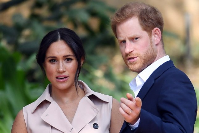 Britain's Prince Harry, Duke of Sussex (R) and his wife Meghan, Duchess of Sussex, attend a reception in Johannesburg, South Africa, on October 2, 2019. File photo by Facundo Arrizabalaga/EPA-EFE