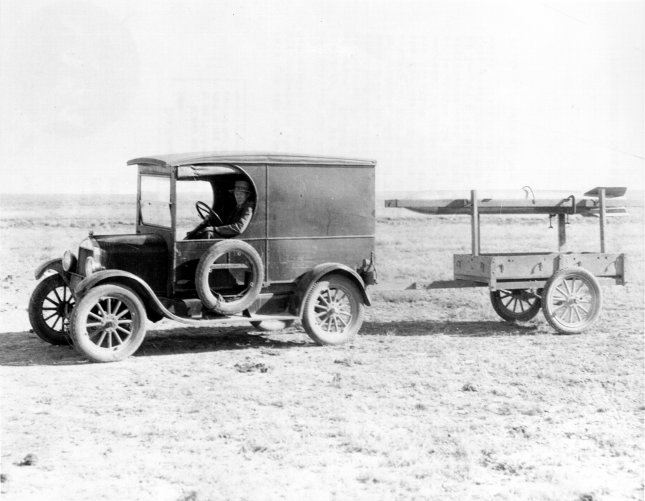 Dr. Robert H. Goddard tows his rocket to the launching tower behind a Model A Ford truck, 15 miles northwest of Roswell, New Mexico, circa 1930-1932. File Photo by NASA/UPI