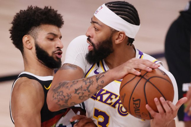 Los Angeles Lakers forward Anthony Davis (R) scored 34 points and had five rebounds, three assists and three steals in a Game 4 win over the Denver Nuggets on Thursday in Orlando, Fla. Photo by Erik S. Lesser/EPA-EFE