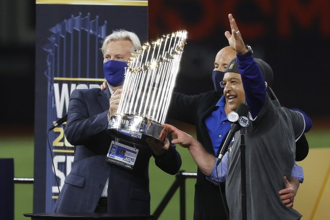 Los Angeles Dodgers chairman Mark Walter (L) and manager Dave Roberts (R) celebrate with the Commissioner's Trophy after defeating the Tampa Bay Rays in Game 6 of the World Series on Tuesday night at Globe Life Field in Arlington, Texas. Photo by John G. Mabanglo/EPA-EFE