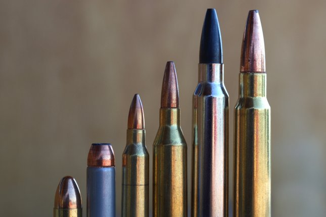 A group of pistol and rifle bullets. Photo by Michael Coddington/Shutterstock