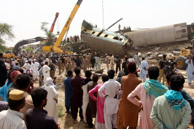 Rescue workers are seen Monday at the site of a train collision in Dharki, Sindh province, Pakistan. At least 40 people were killed in the crash. Photo by Waqar Hussein/EPA-EFE