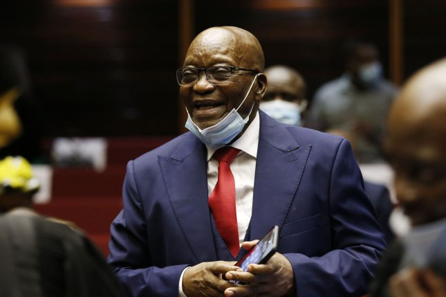 Former South African president Jacob Zuma appears in court during his corruption trial in May. He challenged the court's order to a 15-month prison sentence for contempt. File Photo by PHILL MAGAKOE / EPA-EFE