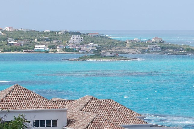 The island nation of Anguilla -- Scilly cay in Island Harbour, Anguilla, is pictured -- is one of three nations removed from the EU list of non-cooperative jurisdictions for tax purposes, the European Council said Tuesday. Photo by Hogweard/Wikimedia Commons