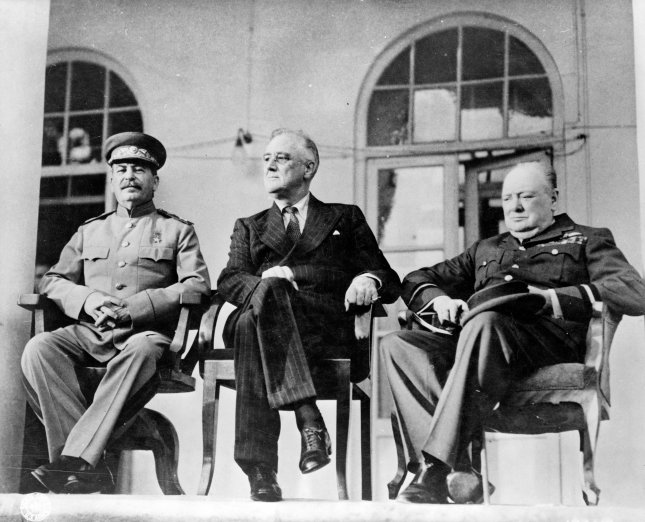 The Big Three -- from left to right: Joseph Stalin, Franklin D. Roosevelt, and Winston Churchill gather on the portico of the Russian Embassy during the Tehran Conference to discuss the European Theatre in 1943. File Photo by Library of Congress/UPI