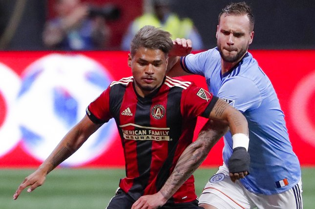 Atlanta United forward Josef Martinez (L) of Venezuela in action against New York City defender Maxime Chanot (R) of France during the second half of an MLS soccer match between the New York City FC and Atlanta United FC on April 15 at Mercedes-Benz Stadium in Atlanta. Photo by Erik S. Lesser/EPA-EFE