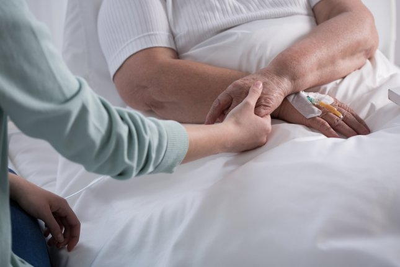 hospice care elderly geriatric nurse family daughter mother cancer palliative treatment hospital. Photo by Photographee.eu/Shutterstock