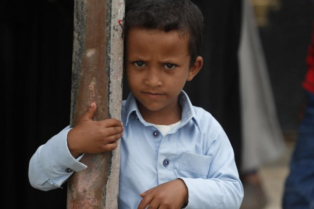 A Yemeni child waits to get his family's food rations in Sana'a, Yemen, on Thursday. U.N. officials said a possible oil leak from a disabled tanker moored off the country's coast could worsen conditions for Yemen's famine-stricken population. Photo by Yahya Arhab/EPA-EFE