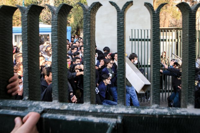 Iranian students clash with riot police during an anti-government protest around the University of Tehran, Iran, Dec. 30. Photo by STR/EPA-EFE