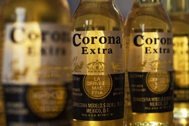Mexican brewer Grupo Modelo, maker of Corona beer, is temporarily halting production due to the coronavirus pandemic. File photo by Hannah McKay/EPA-EFE