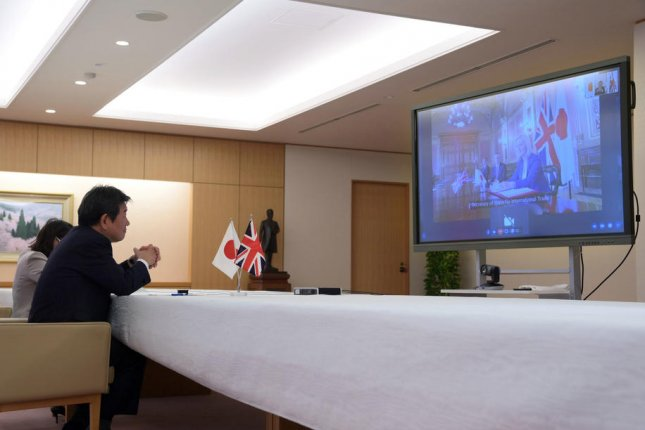 Japanese foreign minister Toshimitsu Motegi speaks remotely with British Secretary of State for International Trade Liz Truss on Friday in Tokyo, Japan. Photo by EPA-EFE/Pool