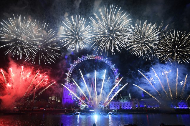 Fireworks fall across the London skyline in front of the London Eye to celebrate the new year on January 1, in London, Britain. File Photo by Andy Rain/EPA-EFE