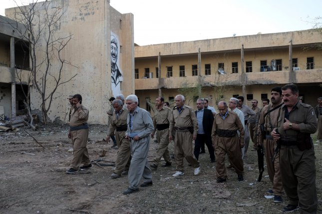 Inspections are conducted at the Kurdistan Democratic Party headquarters in the Kurdistan Region's Koya city, Iraq, after a missile attack Saturday that killed at least 12 people and wounded 50 others. Photo by Gailan Haji/EPA-EFE