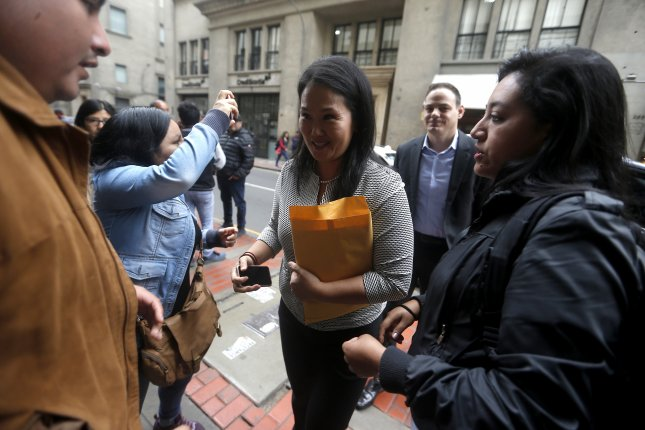 Peruvian opposition leader Keiko Fujimori (C) was detained Wednesday for allegedly receiving illicit donations for her 2011 presidential campaign. Photo by Mario Zapata/EPA