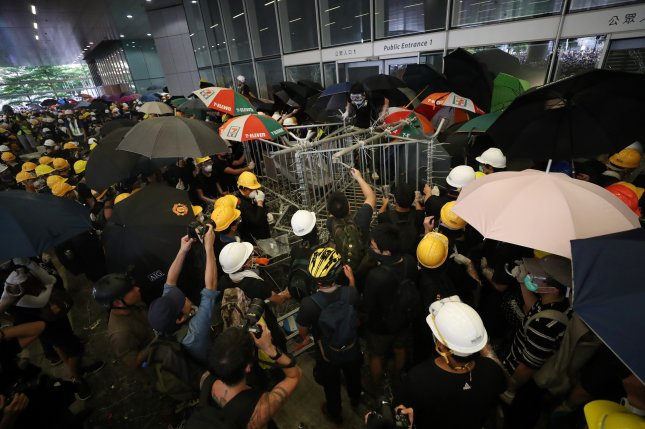 Protesters try to break into the Legislative Council building Monday during a pro-democracy march in Hong Kong. Photo by Ritchie B. Tongo/EPA-EFE