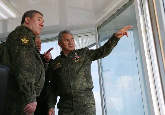 Russian Defense Minister Army General Sergei Shoigu (R) and Chief of the Russian General Staff Valery Gerasimov (L) attend Thursday Russian military exercise at the at Opuk range in Crimea. Photo by Vadim Savitsky/EPA-EFE/Handout