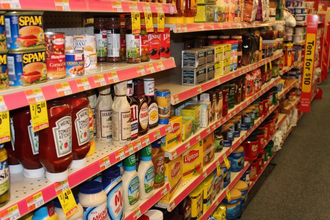 Reckitt leads Britain's FTSE up on food business sale