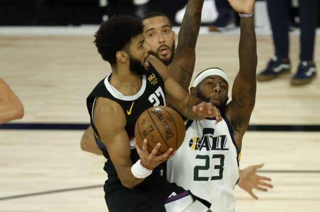 Denver Nuggets guard Jamal Murray (L) drives to the basket as Utah Jazz forward Royce O'Neale (23) defends during the first half of Game 5 in their first-round playoff series Tuesday at the ESPN Wide World of Sports Complex near Orlando, Fla. Photo by John G. Mabanglo/EPA-EFE