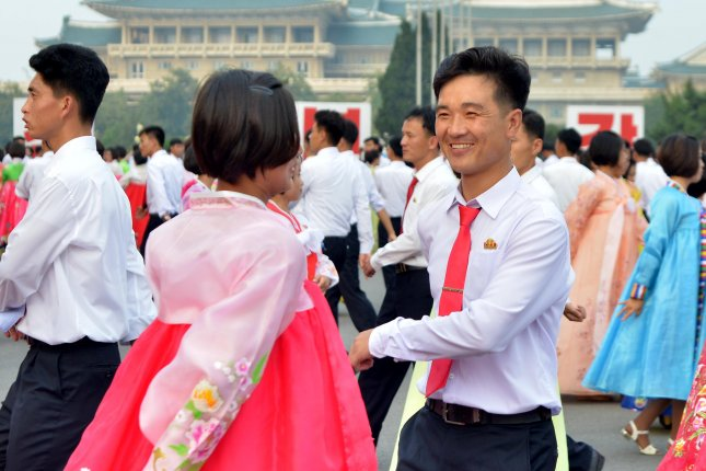 North Koreans dance at an event in Pyongyang, North Korea, on September 9 in celebration of the North Korean government's establishment. Photo by EPA/Yonhap
