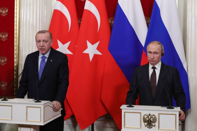Russian President Vladimir Putin (R) and Turkish President Recep Tayyip Erdogan (L) attend a joint news conference in Moscow on March 5. The Trump administration Monday sanctioned Turkey for its purchase of a Russian-made missile system. Photo by Michael Klimentyev/Sputnik-EPA-EFE