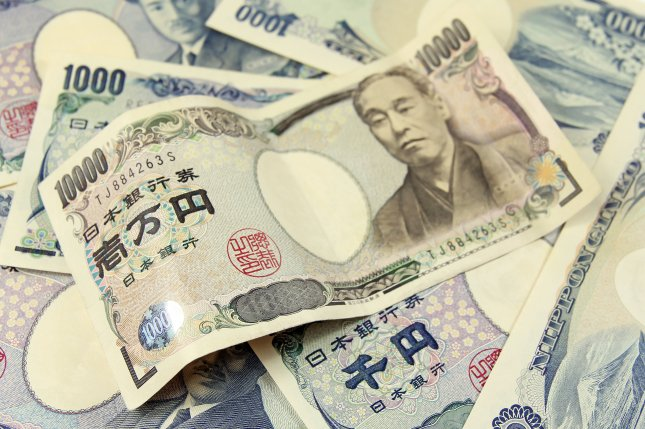 Despite Tokyo's aggressive to stimulate domestic consumption, the weaker yen and a consumption tax hike in April 2014 have resulted in driving up the cost of living for ordinary Japanese. File photo chrupka/Shutterstock