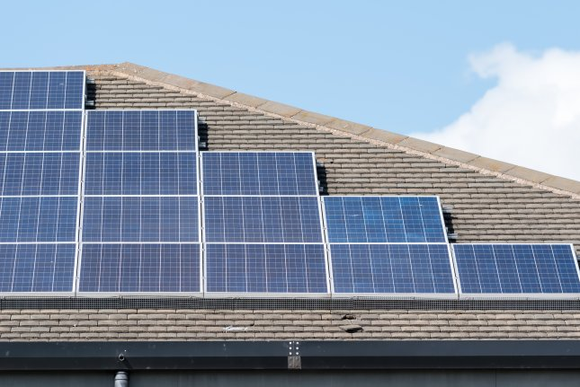 A British solar park would pale the number of those found on a typical rooftop. Photo by Craig Russell/Shutterstock