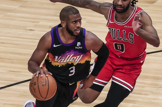 Phoenix Suns guard Chris Paul (L), shown Feb. 26, 2021, finished with seven points and eight assists over 36 minutes against the Los Angeles Lakers on Sunday. File Photo by Tannen Maury/EPA-EFE