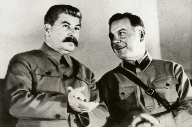Josef Stalin, dictator of Russian (L) is pictured with Minister of War Kliment Voroshilov on the presidium of the conference of men and women Stakhanovite workers in the Grand Hall of the Kremlin Palace in Moscow in December 1935. On March 3, 1938, the last of three of Stalin's public show trials began, with the defendants being charged in a plot to murder Stalin. UPI File Photo