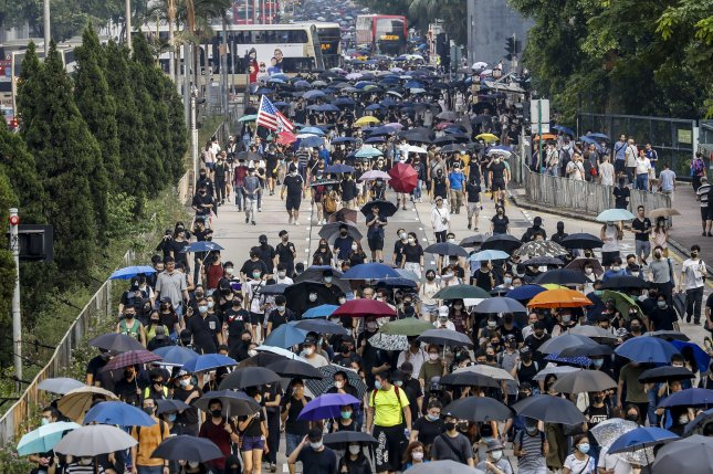 Protesters march during anti-government protest in Hong Kong on Saturday. Photo by Jeon Heon-Kyun/EPA-EFE