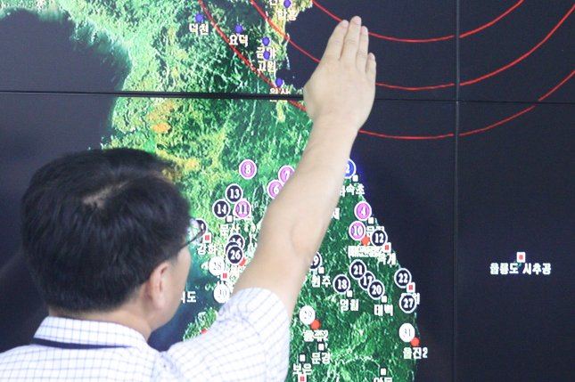 A South Korean official points to North Korea's northeastern county of Kilju, where the country conducted its fifth nuclear test on Sept. 9. More politicians in South Korea are calling for Seoul to develop nuclear weapons in response to provocations and potential changes in U.S. policy. Photo by Yonhap/UPI