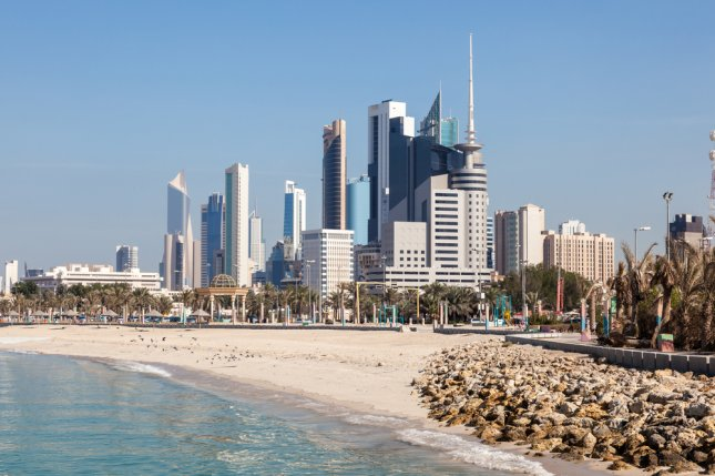 Skyline of Kuwait City, Kuwait. Moody's Investors Service sees Kuwait's economy exposed to risk because of its heavy dependence on oil. Photo by Philip Lange/ Shutterstock.com