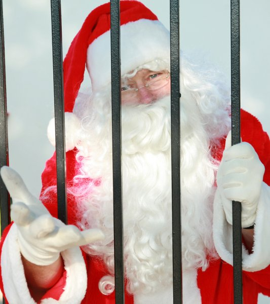 A man dressed as Santa Claus climbed in a KFC drive-through window and demanded cash. Photo by mikeledray/Shutterstock.com