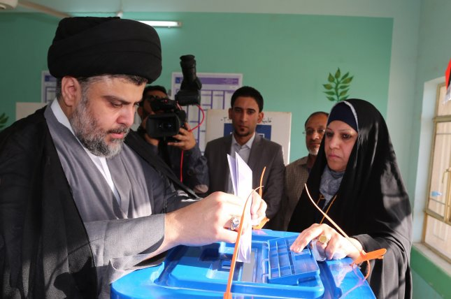 Muqtada al-Sadr, the leader of the Sairoon alliance, announced plans Tuesday to partner with Iraq's pro-Iranian coalition. File photo by Khider Abbas/EPA-EFE