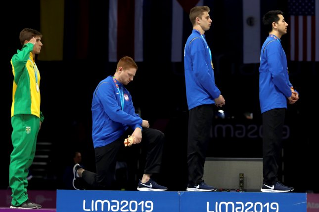 American fencer Race Imboden knelt in protest while at the 2019 Pan American Games in Lima, but would face punishment if he did so at the 2021 Summer Games in Tokyo. File Photo by Juan Ponce/EPA-EFE