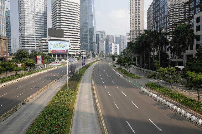 An empty road as seen in Jakarta, Indonesia, on Sunday. Indonesian authorities impose tighter restrictions from Saturday through July 20. Photo by Adi Weda/EPA-EFE