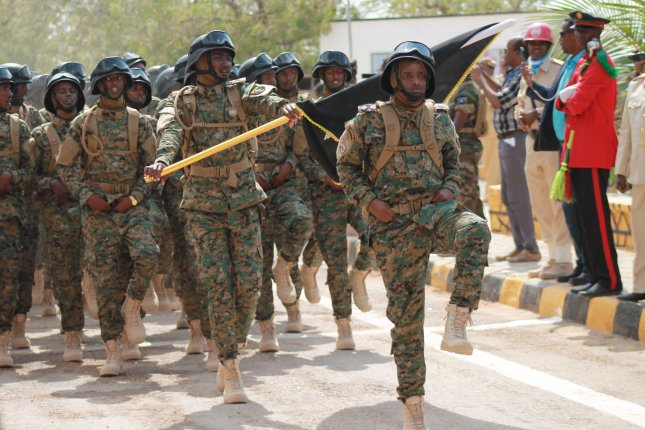 Somali soldiers parade, celebrating the 57th anniversary of Ministry of Defense in Mogadishu, Somalia on Wednesday. The Pentagon said a group of 40 soldiers from ther 101st Airborne Division will be deployed to help train the Somali army on logistics, the largest U.S. deployment there since the 1993 incident known as Black Hawk Down. Photo by Said Yusuf Warsame/EPA