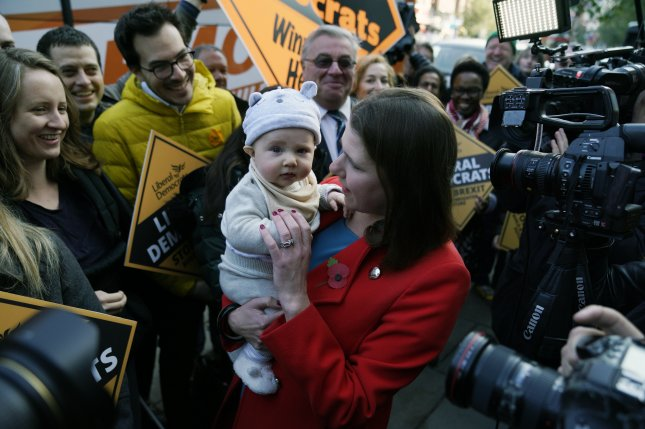 Liberal Democrat Leader Jo Swinson holds a newborn during a campaign event in central London, Britain. Photo by Will Oliver/EPA-EFE
