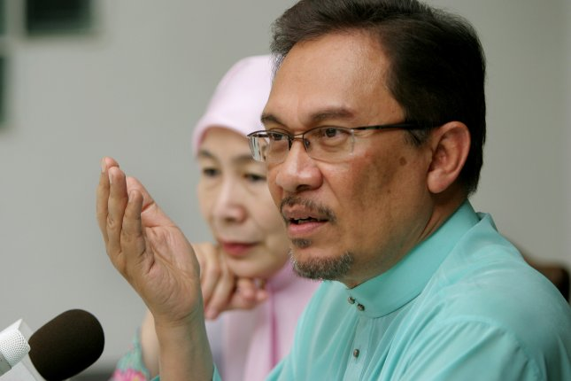 Anwar Ibrahim, an opposition leader jailed on charges of sodomy, was the focus of a Malaysian cartoonist's criticism of the ruling party. Ibrahim was sentenced to five years in jail after a Malaysian court overturned a previous sodomy acquittal in March. Photo by imagemaker/Shutterstock