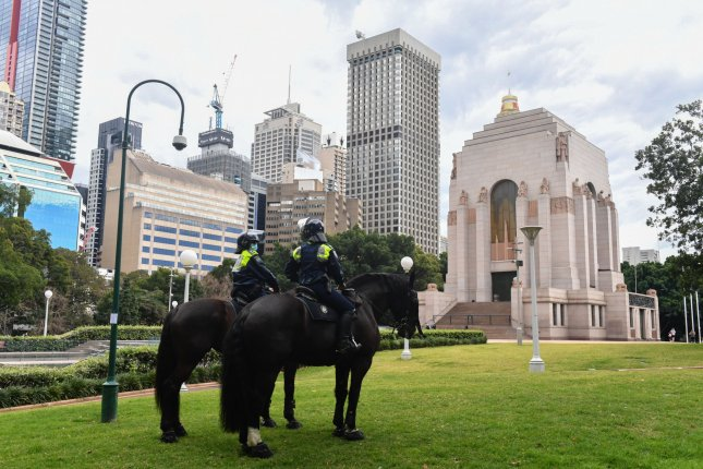 New South Wales police patrol Hyde Park Saturday in anticipation of an anti-lockdown rally in Sydney, which was averted. Photo by Mick Tsikas/EPA-EFE