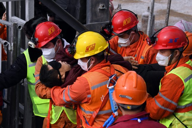 First of 22 Chinese miners trapped in gold mine rescued